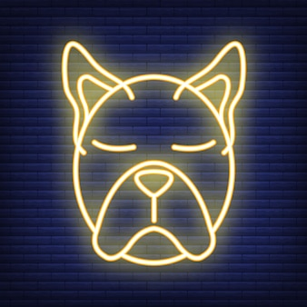 Dog face neon icon. concept for healthcare medicine and pet care. outline and black domestic animal. pets symbol, icon and badge. simple vector illustration on dark brickwork.