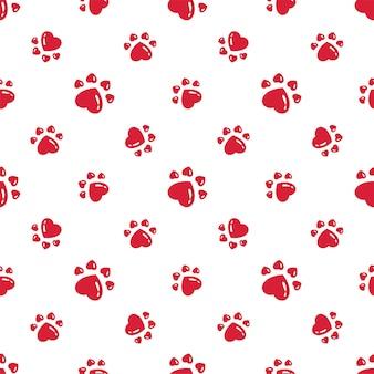 犬の足跡のシームレスなパターンの心臓の足