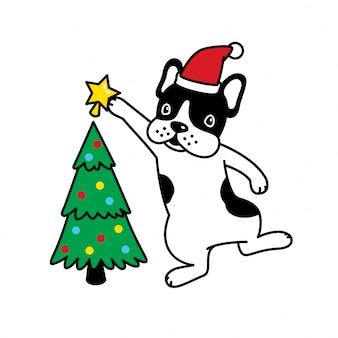 犬のフレンチブルドッグはクリスマスツリーに星を置く