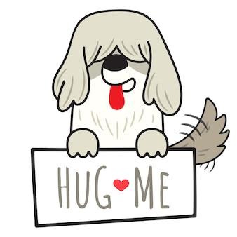 Dog old english sheepdog holding board with write hug me.