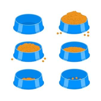 개 또는 고양이 사료 그릇 애완 동물 플라스틱 접시가 비어 있고 건조한 음식으로 가득 차 있습니다.