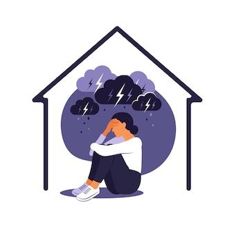 女性に対する家庭内暴力の概念。女性は雨の嵐の雲の下で家で一人で座っています。彼女は痛みで体を抱きしめている。