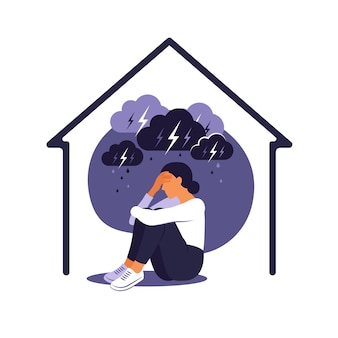 Domestic violence against women concept. woman sits alone at home under rainy stormy cloud. her embraces her body in pain.