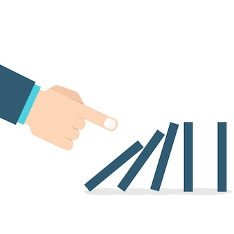 Domino effect. hand pushing the domino.