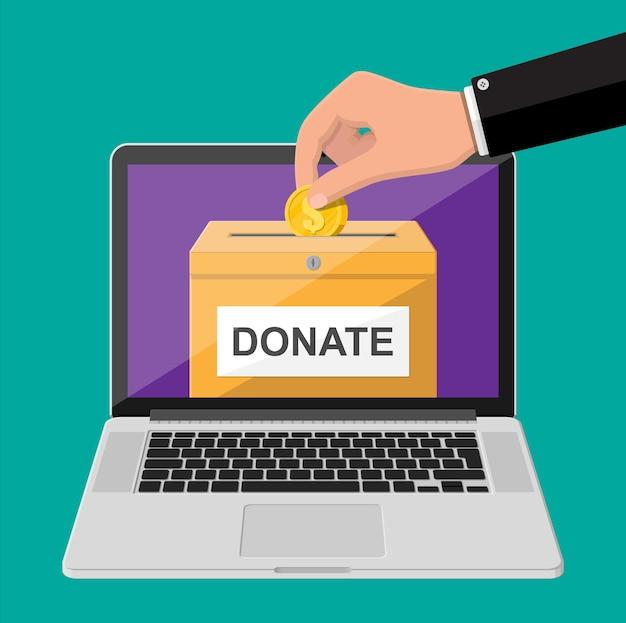 온라인 개념을 기부하십시오. 황금 동전과 노트북 기부 상자입니다. 자선, 기부, 도움 및 원조 개념.