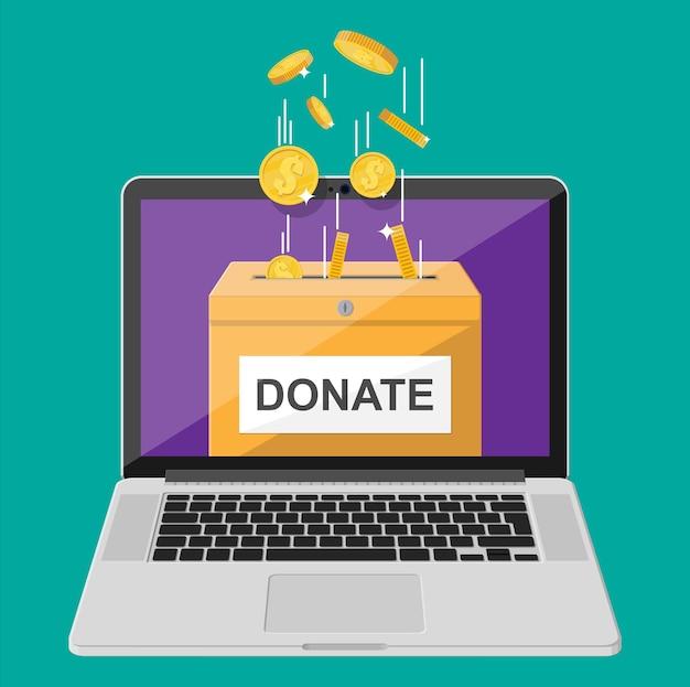 온라인 개념을 기부하십시오. 황금 동전과 노트북 기부 상자입니다. 자선, 기부, 도움 및 원조