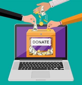 オンラインコンセプトを寄付します。金貨、ドル紙幣、ノートパソコンが入った募金箱。チャリティー、寄付、支援、援助のコンセプト。