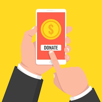 Donate online concept phone with gold coins