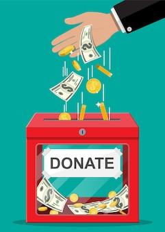황금 동전과 달러 지폐와 기부금 상자입니다. 자선, 기부, 도움 및 원조 개념.