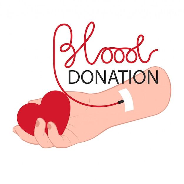 心臓と献血の日の献血概念をレタリングとドナー腕