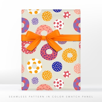 Donut cake with topping or frosting packaging or gift wrapping paper. gift box with ribbon