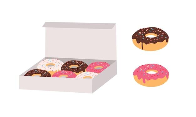 Пончики, глазированные разноцветной сахарной и шоколадной глазурью и посыпанные долькой, лежат в картонной коробке