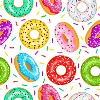 Бесшовный узор пончики для ткани, оберточной бумаги, обоев, фона для сайта. образец ярких разноцветных пончиков в глазури на белом фоне.