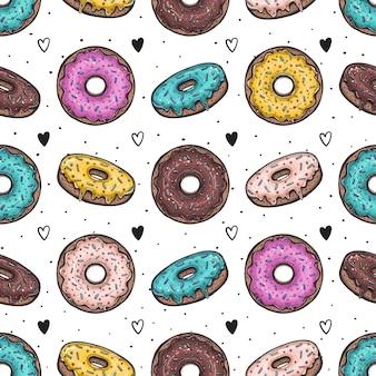 カラフルなグレージングのドーナツ。シームレスパターン。