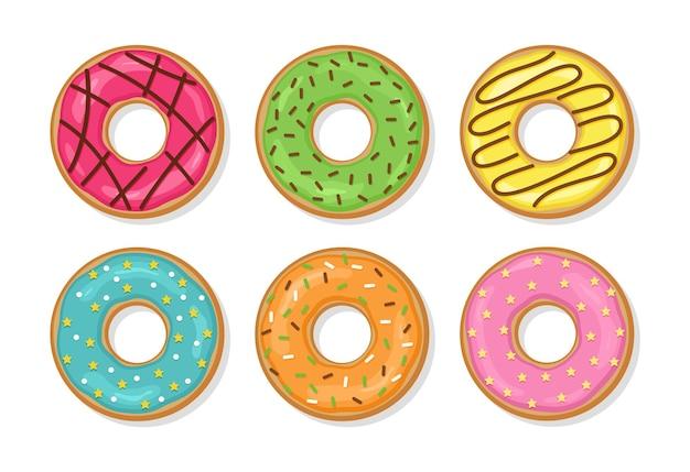 Пончики с глазурью и глянцевой глазурью. установите сладкие пончики. вид сверху на день рождения печенья
