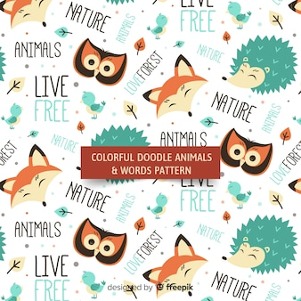 Doodle animals and words pattern