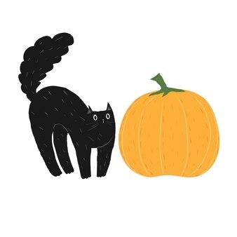 ハロウィーンのカボチャと黒猫を落書き野菜に怖がっているかわいい動物ふわふわの子猫