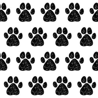 落書き犬の足のシームレスなパターンの背景。カード、招待状、獣医クリニックのポスター、テキスタイル、バッグプリント、現代のワークショップ広告などの抽象的な犬の足跡見本。