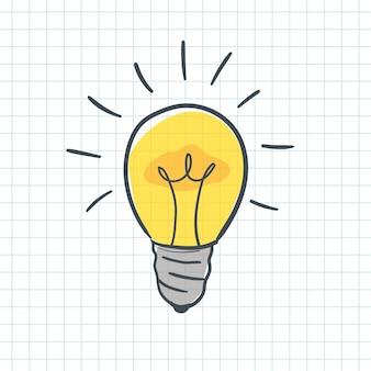 手描きの輝く黄色い電球を落書き