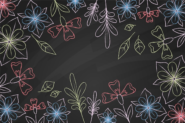 Doodles of flowers on blackboard background