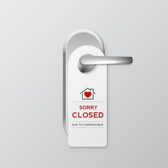 Door hanging sign on home or shop and hotel displaying the message sorry closed due to coronavirus