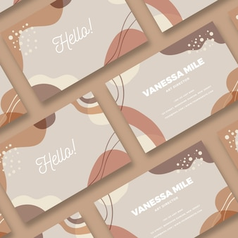 Dots and pastel-coloured stains on business card