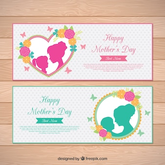 Dotted banners with flowers and silhouettes for mother's day