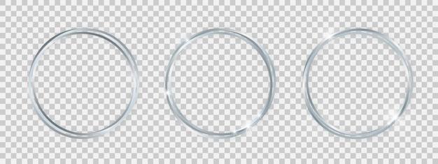 輝く効果のある二重の丸い光沢のあるフレーム。透明な背景に影付きの3つの銀の二重丸フレームのセットです。ベクトルイラスト
