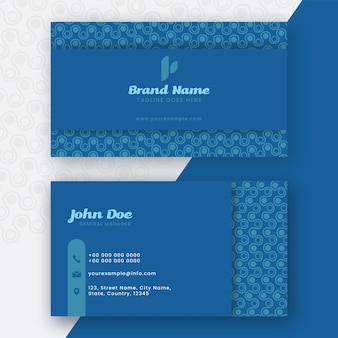 Двусторонняя визитная карточка или визитка синего цвета.
