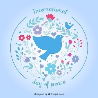 平和の日の花の背景と鳩