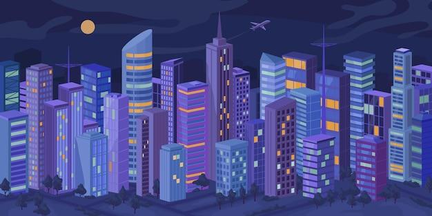 저녁에 조명이 켜진 창문이 있는 도시 건물의 야간 외관 외관