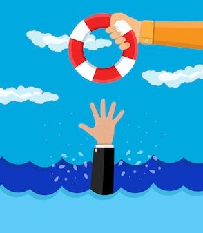 Drれているビジネスマンは救命浮輪を取得します