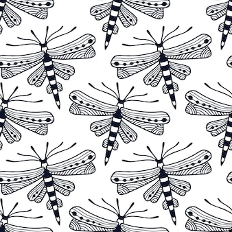 Dragonflies seamless pattern in ornamental hand drawn style. block print textile design with cute black and white dragonfly.