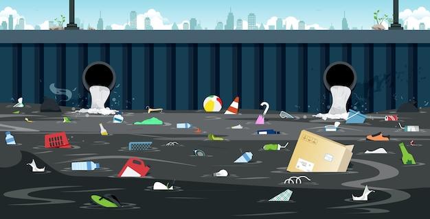 도시의 더러운 쓰레기가있는 배수 파이프.