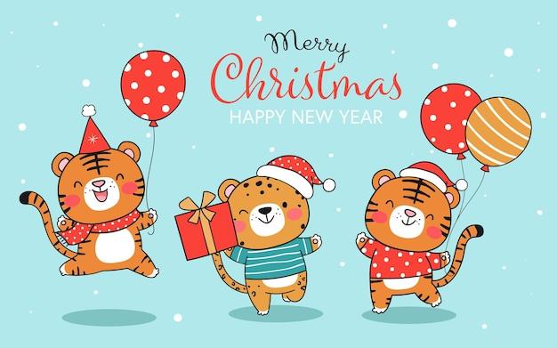 クリスマスの風船とギフトボックスを保持しているバナー面白い虎を描く
