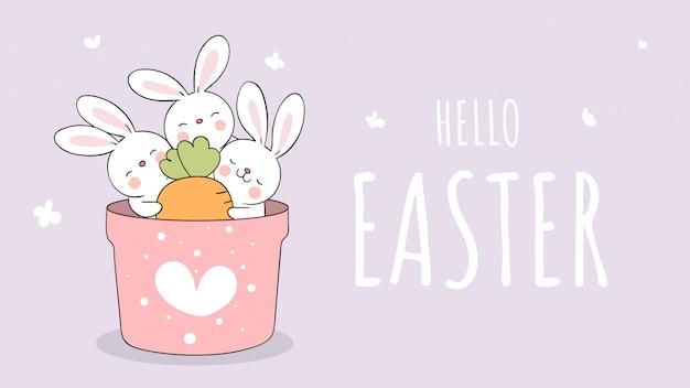 イースターと春の庭の鍋にバナーウサギとニンジンを描きます。