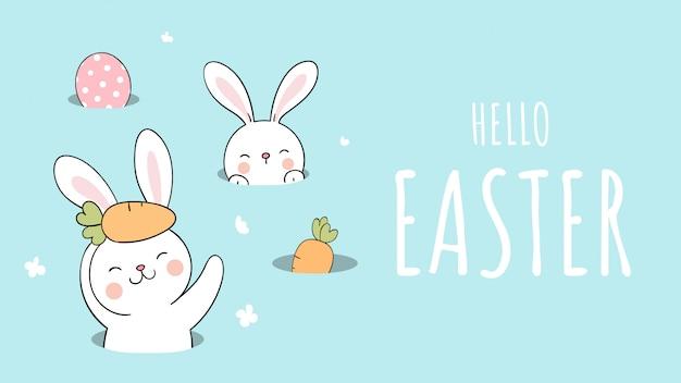 イースターと春のために穴にバナーウサギを描きます。