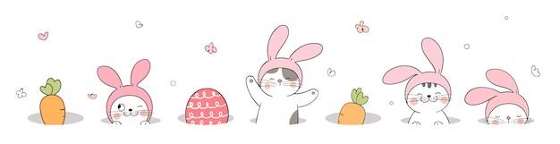 イースターの日のために、穴に猫と卵を描きます。