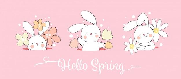 부활절과 봄에 구멍에 귀여운 토끼와 꽃을 그립니다.