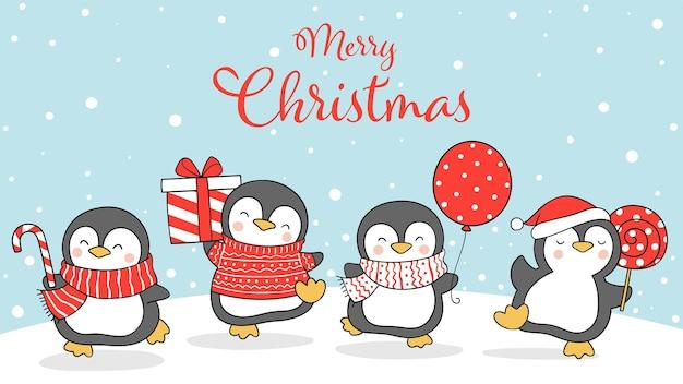 겨울과 크리스마스를 위해 눈 속에서 펭귄을 그립니다.