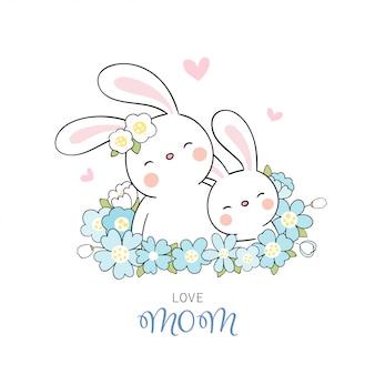 母の日のために白に青い花でウサギと赤ちゃんを描きます。