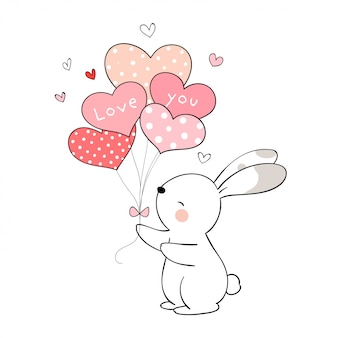 Draw rabbit holding balloon for valentine's day.