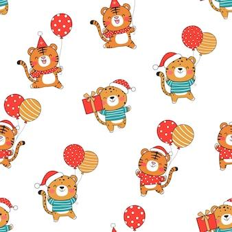Нарисуйте бесшовные модели забавного тигренка с воздушным шаром на рождество