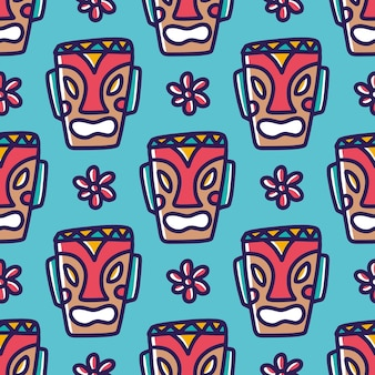 Drawing of hand drawn hawaii tiki mask with icons and design elements