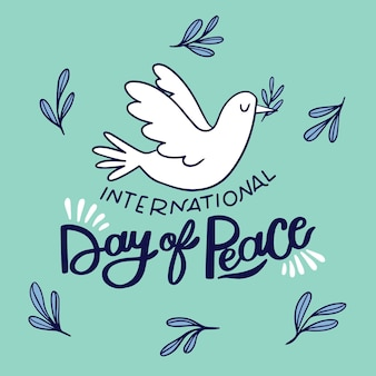 Drawn bird and peace day lettering