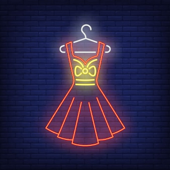 Dress on hanger neon sign.