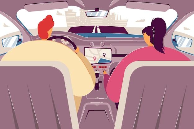 Водитель и пассажир с помощью навигационного приложения внутри автомобиля