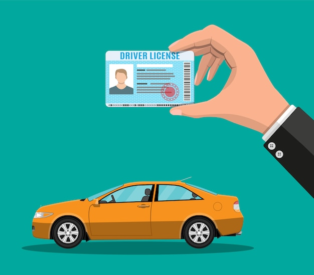 手に運転免許証とオレンジ色のセダン車