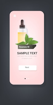 Dropping essential rosemary oil glass bottle with yellow liquid and green leaves natural face body beauty remedies concept smartphone screen mobile app copy space vertical