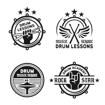 Drum school or drum lessons set of four vector vintage monochrome labels, badges, emblems isolated on white